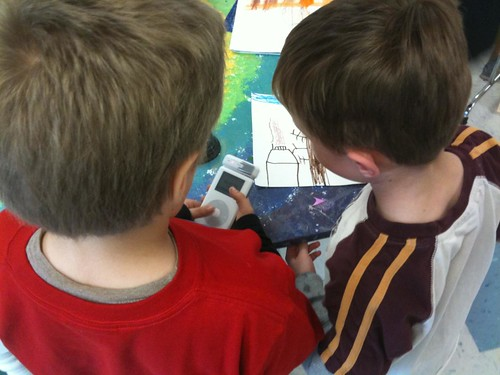 Students recording audio about a picture using an iPod