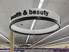 The circle of health and beauty in the sky. (Tim Kiser) Tags: 2015 20150713 almay capitalregion covergirl eastlansing eastlansingmeijer eastlansingmeijerstore eastlansingmichigan img6434 inghamcounty inghamcountymichigan july july2015 loreal lakelansingmeijer lakelansingmeijerstore lakelansingroadmeijer lakelansingroadmeijerstore lansingmetropolitanarea meijer meijerinc meijerhealthbeauty meijerhealthbeautydepartment meijerhealthandbeauty meijerhealthandbeautydepartment meijerstore meijerstoreinterior michigan revlon alllowercase ampersand beauty beautyculture beautysupplies ceiling centralmichigan circulardesign circularsign cosmetics fluorescentlight fluorescentlighttubes fluorescentlighting fluorescenttubes health healthbeauty healthbeautydepartment healthbeautyproducts healthbeautysign healthbeautysupplies healthandbeauty healthandbeautydepartment healthandbeautyproducts healthandbeautysign healthandbeautysupplies healthgoods healthproducts insideameijer insideameijerstore lowercaseletters midmichigan roundsign sign southcentralmichigan sportinggoods sportinggoodssign unitedstates us