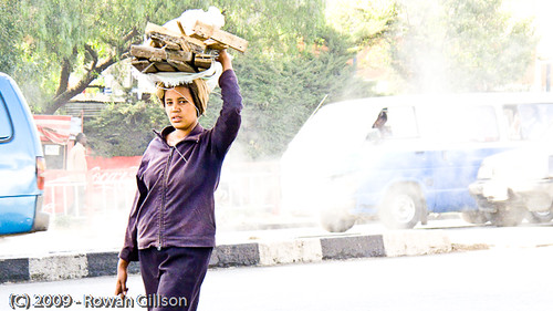 An Ethiopian woman carries a bundle of wood on her head in Addis Ababa.