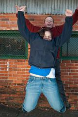 1, 2, 3, JUMP (thinson07) Tags: blue red portrait green wall umbrella fun nikon bricks sb600 siblings brickwall nikkor brotherandsister softbox wilmingtonnc christmasgift downtownwilmington d60 jumpshot orangestreet 1855mmf3556gvr photoshopelements60macintosh