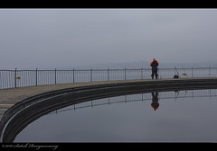 (Satish Rangaswamy) Tags: morning bridge orange mist lake water reflections photography switzerland fishing europe zurich satish tiefenbrunnen rangaswamy canon40d