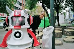Robot and Old man (deepstoat) Tags: street zeiss 35mm robot zimmer taiwan shock contaxg2 kodakportra deepstoat