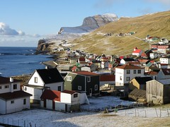 Sumba - A Village in Suduroy in the Faroe Islands - Froyar (Eileen Sand) Tags: ocean houses winter sea mountain snow tourism church island islands coast village horizon atlantic coastline february wintertime scandinavia islas faroeislands faroe northatlantic sumba holidayhome faroes feroe froyar frarna fryene freyjar vacationrental frerne faeroe faroese frer suuroy foroyar beinisvr suduroy lesfro ilesfro sumbiarkirkja islasferoe isolefrer beinisvord sunnbur    eileensand wyspyowcze visitsuduroy islandjumping