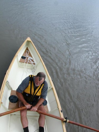 Tom in his wooden boat on the river at Nudgee.