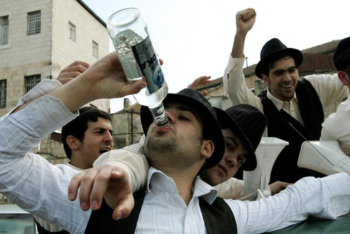 Orthodox men celebrate Purim. Jerusalem, 2007.
