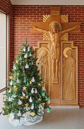 Saint Mary Roman Catholic Church, in Trenton, Illinois, USA - crucifix and Christmas tree in narthex