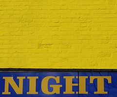 Night Wall (Tony Worrall) Tags: uk england urban cold color building art geometric sign yellow night contrast design cool nw pattern colours northwest notice painted banner style clash lancashire line brickwall signage preston blocks split shape minimalist lancs