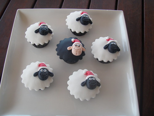 Mossy's Masterpiece - Humorous Christmas sheep cupcakes. I call these - Even the black sheep behaves at Christmas!!!