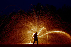 steel wool (Dennis Calvert) Tags: longexposure light red lightpainting motion hot art silhouette night canon fire lights streak rockstar spin alabama flame inferno lighttrails nophotoshop pyro sparks xsi combust combustion steelwool lapp sooc 450d lightjunkie denniscalvert photonmancer