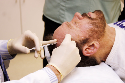 anuary 26, 2010 - Dr. Roger Allcroft administers botox into the forehead of his patient, Dr. John Harris at his medical practice in Northampton.