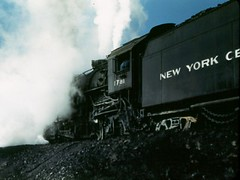 I think these are two ends of the same locomotive, probably an older NYC 2-8-2 (Mikado) type.