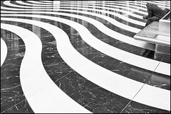 Pondering! (adrians_art) Tags: city blackandwhite abstract reflection london monochrome lines floor patterns curves docklands tiling jubileeplace canarywhalf