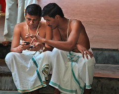 Texting at the temple (chatursunil) Tags: india boys temple indian south cellphone hindu tamilnadu murugan texting tiruchendur
