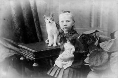 Hulda Lundager with her cat and her doll in Mt. Morgan
