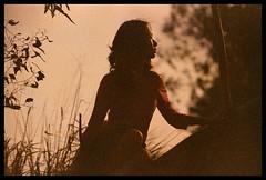 One Nice Day #3 (Lefty Jor) Tags: trees red hk sunlight film girl grass silhouette hongkong leaf xpro day dof kodak bokeh crossprocess slide expired misu 南生圍 f3hp ektachrome160t 50mmf12