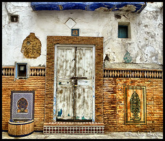 This old house is needin' paint ! (Bashar Shglila) Tags: door old blue white house green art texture colors closed colours morocco hdr asilah    photomatix   arzila  mygearandmepremium mygearandmebronze