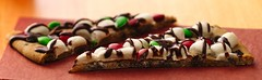 Jingle Bell Cookie Pizza Recipe (Pillsbury.com) Tags: christmas winter party holiday cookies kids guests crust recipe dessert baking candy sweet chocolate fudge pizza marshmallow treat candies pillsbury topping cookiedough drizzle entertaining bakedgoods woodtable chocolatechipcookie minimarshmallows rednapkin pillsburyrecipe jinglebellcookiepizza refrigerateddough