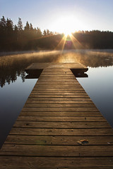 05:24 am (Risto Juntunen) Tags: blue summer mist lake sunrise finland dawn pier dock haze flare sunflare