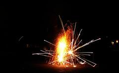 Resist All Things Fleeting (Shrieking Tree) Tags: light night dark fire fireworks firework lone sparks firecrackers firecracker