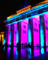 Lilac & Torquoise (Iatrask {{...Photographo ergo sum...}}) Tags: pink blue light cold reflection berlin rain night umbrella germany mirror october gate europe neon brandenburggate festivaloflight lilac german column raining berliner bradenburg torquoise deutch bradndenburgtor annualfestivaloflight