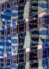 Reflections (Dar's Foto Madness) Tags: blue reflection building minnesota architecture office apartment furniture dar minneapolis blues patio reflective grover lakecalhoun dars calhounbeachclub groverphotos