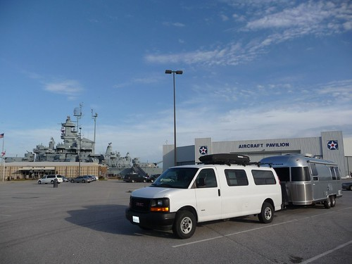 our airstream in front of a battleship.
