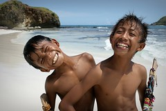 Happy Beach Boys (shafik100) Tags: blue sea vacation white holiday beach boys water indonesia island seaside sand rocks paradise hill lombok kuta beachboys seawater tanjungaan