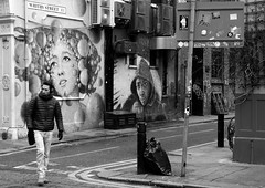 the sound of whitby street (gregjack!) Tags: uk london shoreditch whitbystreet man graffiti mural street streetphotography bnw blackandwhite bw sony rx10m3