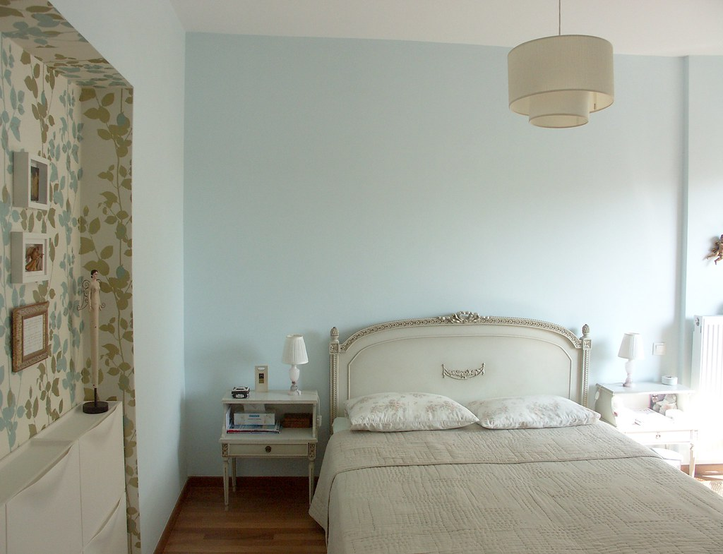Bedroom with wallpapered storage wall
