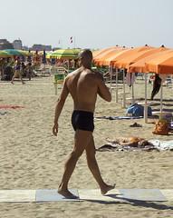 Beach lion checking his territory (Toni Kaarttinen) Tags: sea shirtless italy beach sand italia hunk rimini umbrellas swimsuit riccione swimmingtrunks beachlion