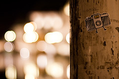Highly Lomo (ukaaa) Tags: wood white black feet yellow night digital lomo lca lomography sticker dof belgium bokeh drawing character belgië pole depthoffield doodle stick illustrator ghent gent waterproof graslei zink polaroidpogo
