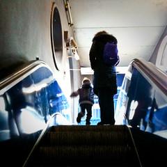[194/365] going up (Alessio Gigli) Tags: blue people backlight dark kid child action blu escalator persone controluce buio scalamobile iphone bambino alessio azione gigli 365days familygetty2010