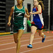 Northwest Catholic's Christine Smith leads East Hampton's Jenna Klamonski for 2nd place in the women's 4x400