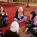 Learning in the mosque (Students listening in Mosque.jpg)