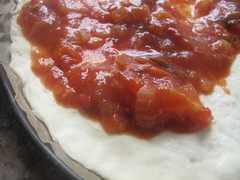 Tomato sauce on pizza