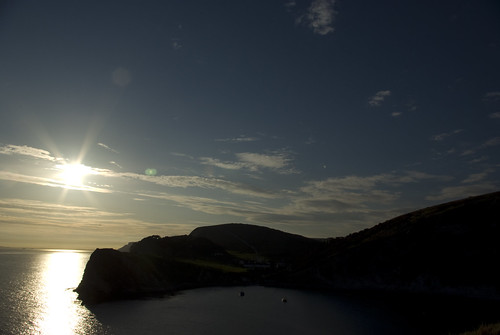 Lulworth Cove Setting Sun - Copyright R.Weal 2009