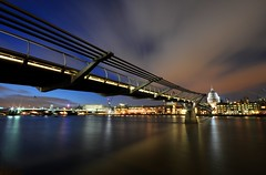 Millennium Bridge at Dusk - London (5ERG10) Tags: uk longexposure bridge blue england sky brown london water sergio thames skyline modern clouds photoshop river lights twilight nikon riverside cathedral suspension tate dusk steel tripod perspective pedestrian wideangle millennium millenniumbridge line ponte diagonal foster blackfriars bluehour saintpaul londra leading sway wobbly shutterrelease bankside inghilterra tamigi cattedrale arup d300 heyheyhey sigma1020 nohdr oscillations amiti 5erg10 sergioamiti
