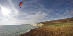 Snow Wight? memories of summer and paragliding over compton bay, Isle of Wight (s0ulsurfing) Tags: ocean blue autumn sea england sky panorama cliff cloud sunlight english texture tourism nature water weather clouds composition rural downs landscape island bay coast countryside flying scenery skies natural compton country flight wide wing perspective wideangle panoramic cliffs september coastal isleofwight vista coastline paragliding gliding glider paraglider landschaft isle 2009 wispy cliche wight bucolic proverb cirrus parapente paraglide freiheit gleitschirm 10mm idiom comptonbay abenteuer sigma1020 ridgesoaring s0ulsurfing ridgelift snowwhatsnow vertorama bucolical iowtourism