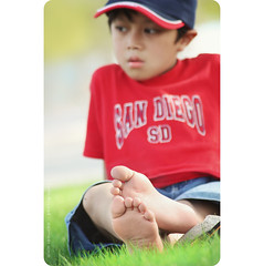 sunny feet (alvin lamucho ) Tags: red portrait green feet grass relax toes dof play