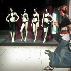 Envy (antonkawasaki) Tags: nyc newyorkcity streetphotography squareformat 14thstreet meatpackingdistrict envy handsonhips 500x500 barelydressed holdingacoffee antonkawasaki iphone3gs glassdoorwindowofclothingstore sexyfemalemannequinsondisplay womanwithlongdenimskirtandblackshawlwalkingbylookinginside