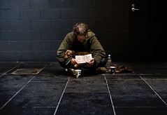homeless (Damien Loverso) Tags: city blue light portrait people food dog man black green sign wall dark puppy photography grey sitting moody pavement bricks homeless tan documentary melbourne sit emotional shelter seated doco sparechange