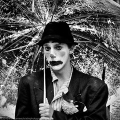 Rain Clown (Photography JC) Tags: flower male hat rain umbrella stem comic hand jester clown grain joker comedian wilted performer pierrot shaft buffoon punchinello