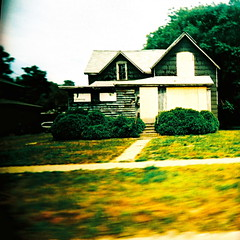 Foreclosure on the American dream (kevin dooley) Tags: white house green film home window up car architecture mi analog america square lens moving lomo xpro lomography crossprocessed mainstreet slim shot angle kodak michigan wide dream plastic american land americana 100 lose viv vivitar economy ultra extra own boarded uws mortgage jobless ownership bentonharbor americandream recession bankruptcy foreclosure ebx vuws vivalaviv foreclosureonamericandream foreclosureontheamericandream