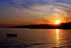 Sunset (mkurtel) Tags: sunset sea reflection clouds turkey landscape boat nikon trkiye mount explore sandal d60 nikond60 altnoluk muratkurtel