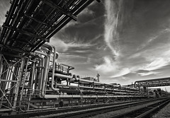 Crude (Bruce Bordelon) Tags: railroad plant industry clouds rouge nikon louisiana industrial natural pipes tracks gas explore oil d200 nikkor refinery pipeline f28 baton chemical exxon explored 1424mm