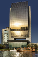 National Bank of Dubai (sminky_pinky100 (In and Out)) Tags: travel sunset reflection tourism water beautiful architecture boat dubai uae dubaicreek curved striking nationalbankofdubai shimmer dhow bej omot