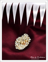 The National day of Qatar (18 Dec)  Natural pearls & Flag (RASHID ALKUBAISI) Tags: nikon december flag doha qatar rashid  d90   18dec qatarflag   alkubaisi   18 ralkubaisi  thenationaldayofqatar