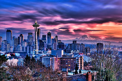 Blazing Seattle Sunset (Surrealize) Tags: seattle city sunset water clouds buildings nikon colorful downtown cityscape dynamic crane dusk scenic location tourist container spaceneedle pugetsound kerrypark shipping popular mtrainier lenticular hdr d300 washngton surrealize