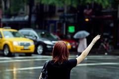 (Samuel Boulitreau) Tags: street new york ny color cars car rain yellow umbrella jaune canon hair day cab taxi pluie voiture jour rainy a1 raining rue couleur voitures parapluie cheveux pluvieux