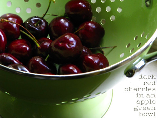 red cherries in a green bowl